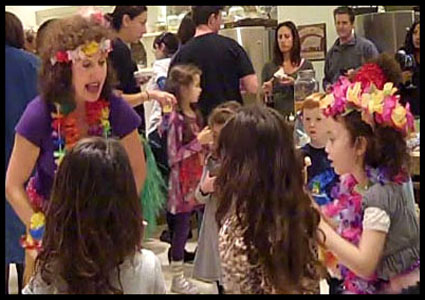 Daisy Doodle gives children a hula dance lesson after her hula dance show