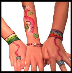 Girls get jewelry body painting on hands at birthday party Long Island NY
