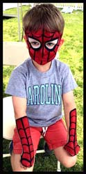 Boy gets spiderman face painting and arms body painted with spider webs at kids party Westchester NY