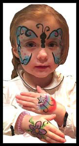 Girl gets butterfly face painting and hands body painted at birthday party Queens NYC