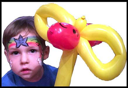 Boys like rainbow face painting too!  Plus balloon twisted bumble bee Westchester NY