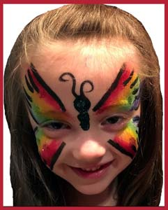 Rainbow butterfly face painting is popular at kids birthday parties in New York City