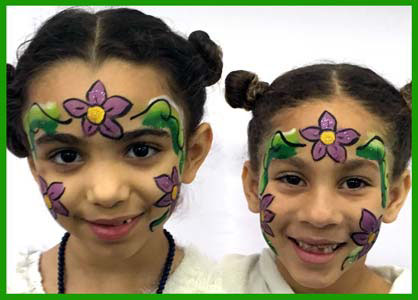 Sisters get facepainted with flowers at birthday party in Brooklyn NYC