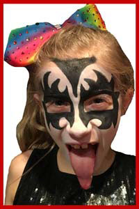 Girl in Westchester NY got face painted as rock star Gene Simmons