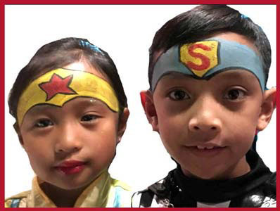 Children are face painted as Superman and Wonderwoman at kids party Bronx NYC