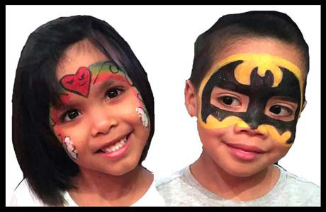 Birthday party twins smile after getting face painted by Daisy Doodle Queens NYC