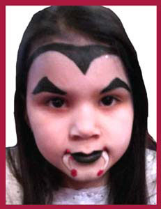 Older girl wanted vampire face painting at Halloween party Brooklyn NYC