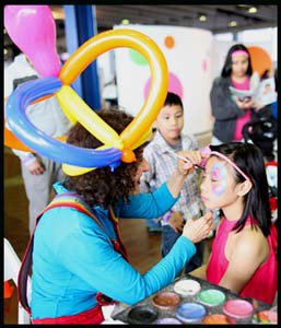 Daisy Doodle face painting child at New York Baby Show Manhattan NYC