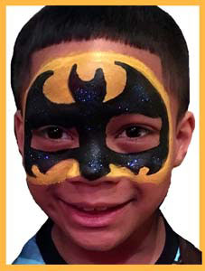Child wears balloon twisted helmut to match his spiderman face painting Jersey City NJ