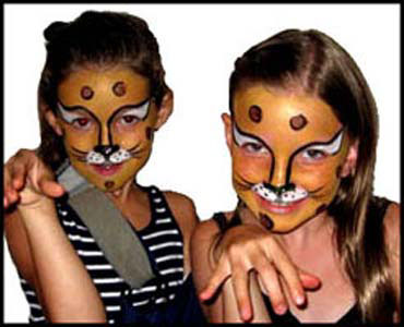 Girls pose in character for cheetah face painting at childrens party in Manhattan NYC