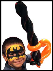 Birthday boy face painted as batman superhero with balloon sword in Bronx NYC