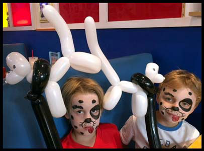 Boys are face painted as dalmations with matching twisted balloon dogs restaurant's Kids Night