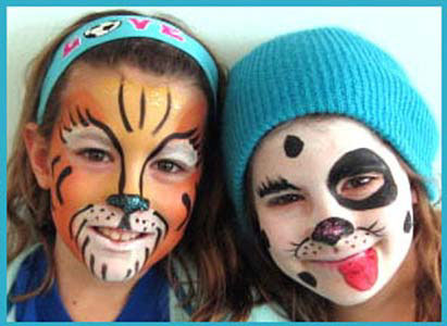 Older girls get face painted as tiger and dalmatian at corporate party in Connecticut