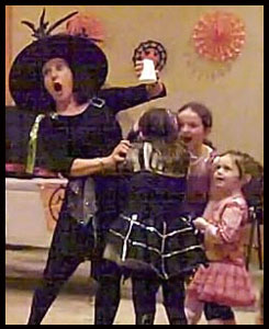 Daisy Doodle interacts with kids participating in her halloween party magic show