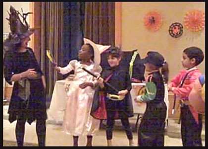 Children help out entertainer Daisy Doodle during the halloween party magic show