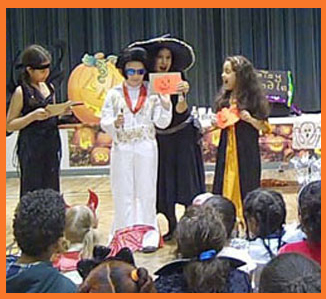 Kids color pumpkins in Daisy Doodle's halloween magic show