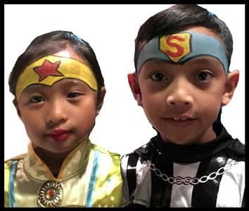 These kids get facepainted as superheros at halloween party in Queens NY