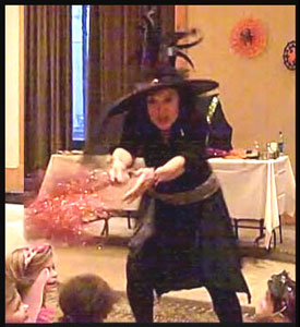 Daisy Doodle Diabolica's dramatic opening number for her halloween kids party magic show in nyc