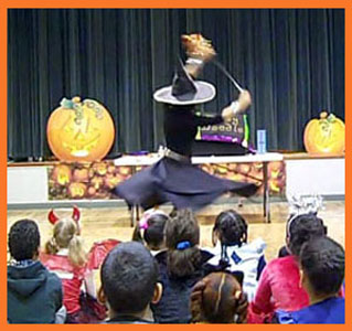 Daisy Doodle Diabolica's opening number to music in her halloween kids party magic show nyc