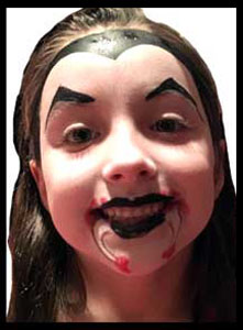Girl gets facepainted as vampire at kids halloween birthday party in nyc