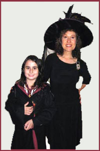 Magician Daisy Doodle and birthday girl in costume for Harry Potter magic show in Bronx NY