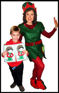 Daisy Doodle dressed as Christmas elf with boy volunteer at kids Christmas holiday magic party in Manhattan NY